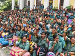 Sanitation workers in a protest from pre-COVID 19 times